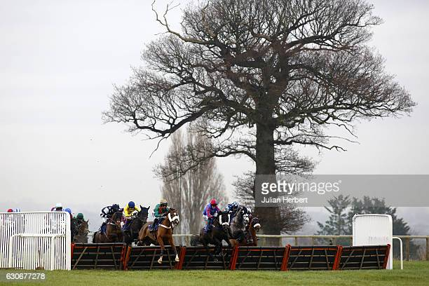 Reilly's Manor ridden by Harry Cobden leads the field over an early flight before going on to win The toteplacepot Six Places In Six Races...