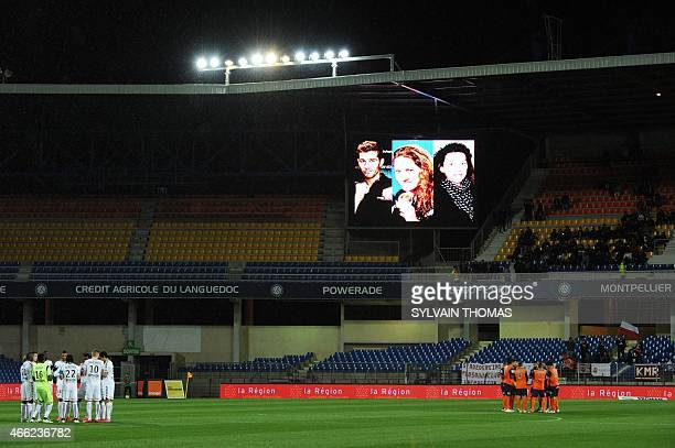 Reims' and Montpellier's players gather for a minute of silence prior the French L1 football match Montpellier vs Reims on March 14 at the Mosson...