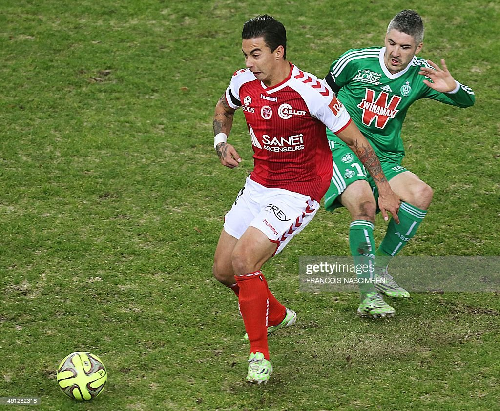 Reims' Brazilian forward Diego Rigonato (L) with for the ball Saint Etienne's French midfielder Fabien Lemoine (R) during the French L1 football match between Reims (RS) and Saint-Etienne (ASSE) on January 10, 2015 at the Auguste Delaune stadium in Reims, eastern France. AFP PHOTO / FRANCOIS NASCIMBENI