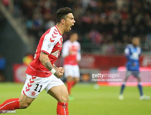 Reims' Brazilian midfielder Diego Rigonato Rodrigues celebrates after scoring a goal during the French Ligue 1 football match between Reims and Lyon...
