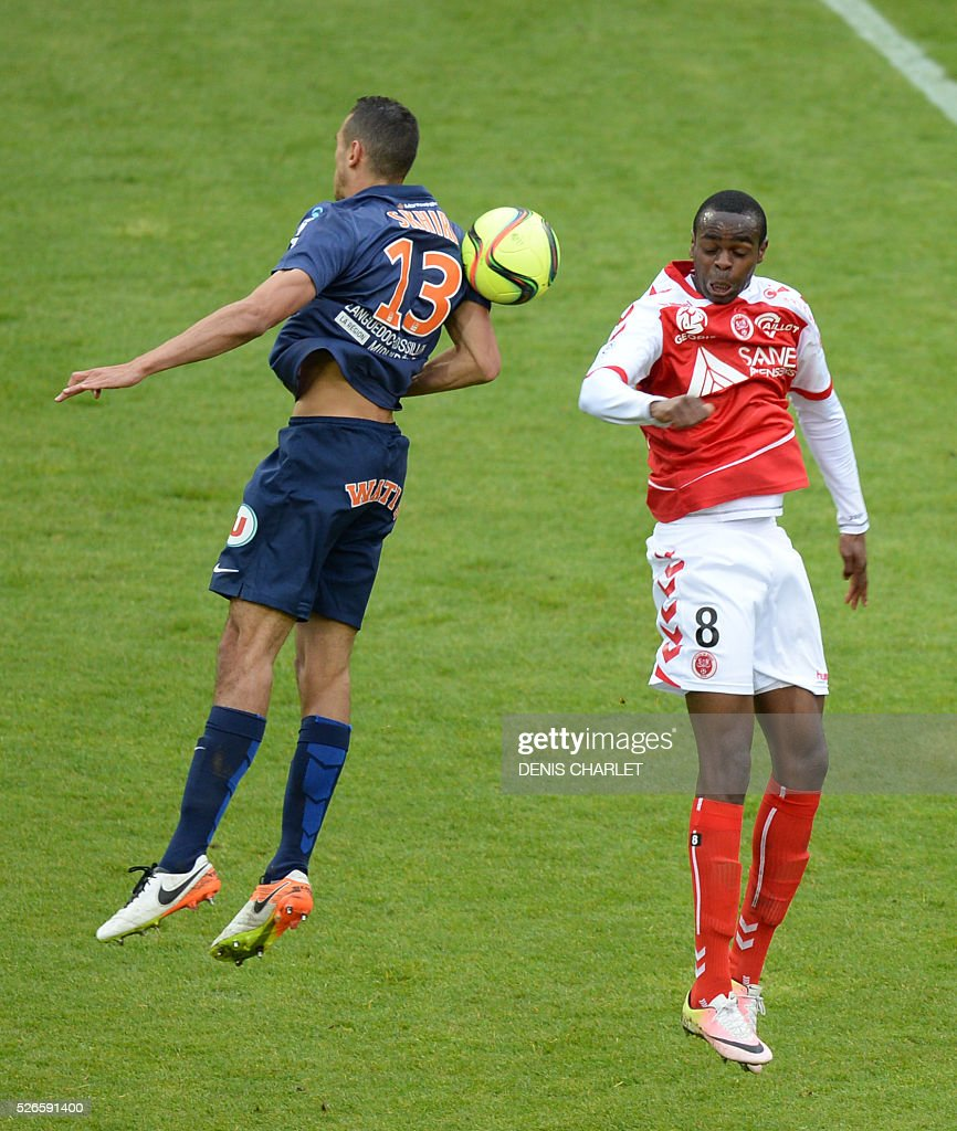 Reims' Congolese midfielder Prince Oniangue (R) vies for the ball with Monpellier's French midfielder Ellyes Skhiri during the French L1 football match between Reims (SDR) and Montpellier (MHSC) on April 30 2016, at the Auguste Delaune Stadium in Reims, eastern France.
