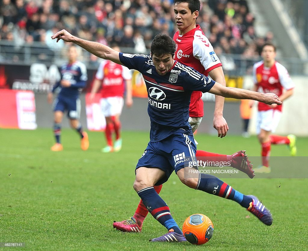 Reims' defender Aissa Mandi (R) vies with Lyon's French midfielder Yoann Gourcuff during the French Football match Reims-Lyon; on January 19, 2014, at the Auguste Delaune Stadium in Reims. PHOTO