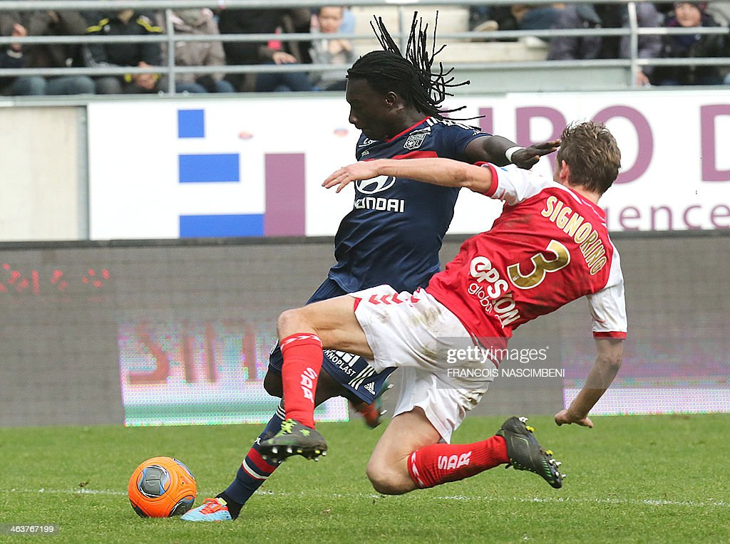 Reims' defender Franck Signorino (R) vies with Lille's forward Bafetimbi Gomis (L) during the French Football match Reims-Lyon; on January 19, 2014, at the Auguste Delaune Stadium in Reims. PHOTO