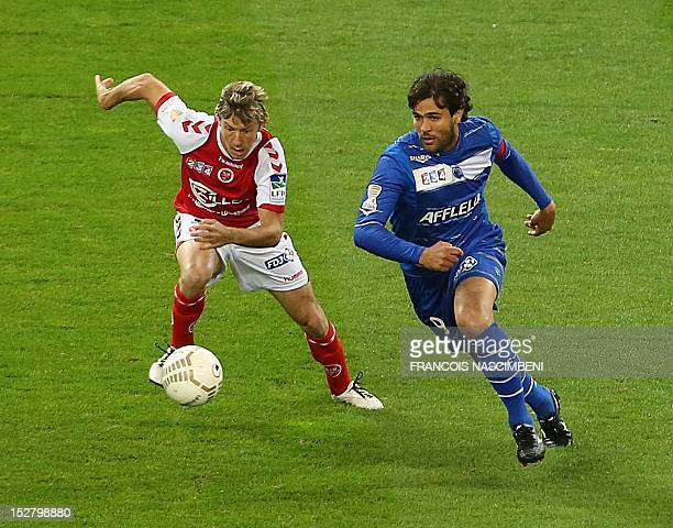 Reims' defender Franck Signorino vies with Troyes' Brasilian forward Marcos on September 26 2012 during the French Ligue Cup football match Reims vs...