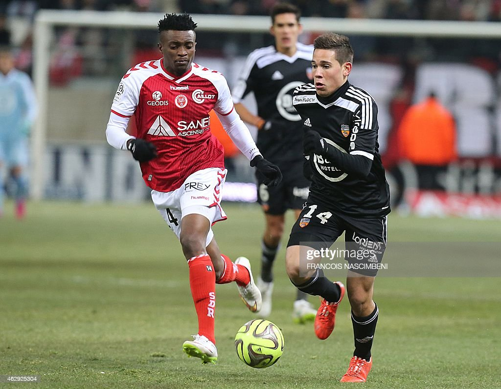 Reims' forward <a gi-track='captionPersonalityLinkClicked' href=/galleries/search?phrase=Benjamin+Moukandjo&family=editorial&specificpeople=7470600 ng-click='$event.stopPropagation()'>Benjamin Moukandjo</a> (L) vies for the ball with Lorient's French Portuguese defender Raphael Guerreiro (R) during the French L1 between Reims and Lorient on February 7, 2015 at the Auguste Delaune Stadium in Reims, eastern France.