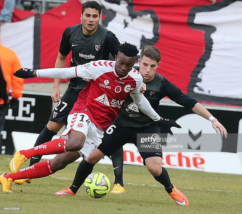 Reims' forward <a gi-track='captionPersonalityLinkClicked' href=/galleries/search?phrase=Benjamin+Moukandjo&family=editorial&specificpeople=7470600 ng-click='$event.stopPropagation()'>Benjamin Moukandjo</a> (C) vies with Metz' midfielder Feriani Sassi (R) during the French Football match between Reims and Metz on February 22, 2015 at the Auguste Delaune Stadium in Reims. PHOTO
