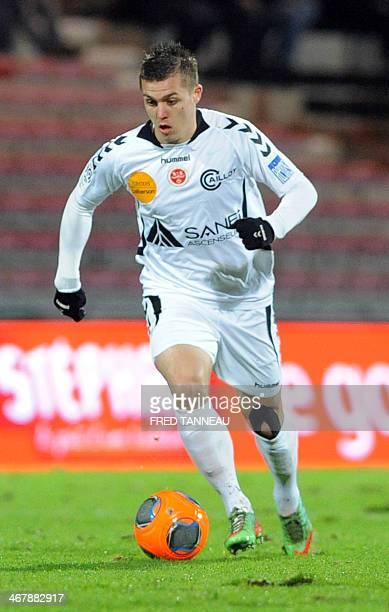 Reims' forward Nicolas de Preville plays the ball during the French L1 football match Guingamp against Reims on February 8 2014 at the Roudourou...