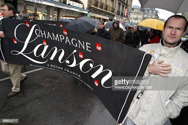 Some 1000 people demonstrate 17 January 2006 in Reims eastern France in support of the 450 employees of French champagne producer Lanson...
