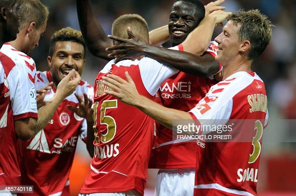 Reims FrancoTurkish defender Atila Turan is congratulated by teammates after scoring a goal during the French L1 football match between Reims and...