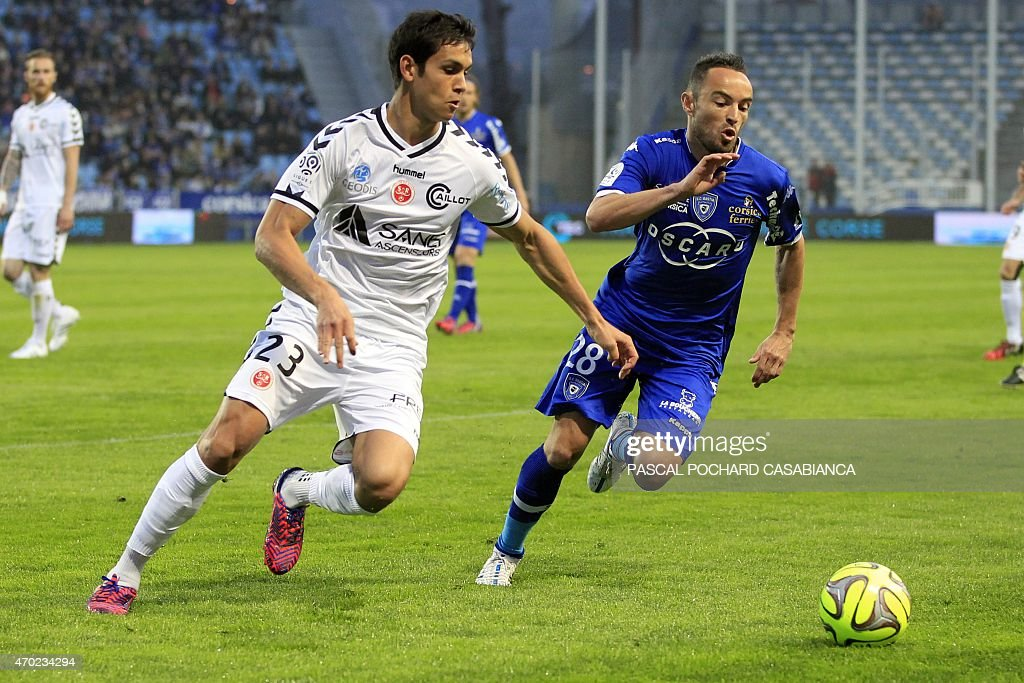 Reims' French Algerian defender Aissa Mandi vies with Bastia's French midfielder <a gi-track='captionPersonalityLinkClicked' href=/galleries/search?phrase=Gael+Danic&family=editorial&specificpeople=650403 ng-click='$event.stopPropagation()'>Gael Danic</a> during the French L1 football match Bastia (SCB) against Reims (SR) on April 18, 2015 at the Armand Cesari stadium in Bastia, on the French Mediterranean island of Corsica.