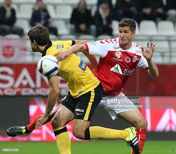 Reims' French defender Anthony Weber vie with Lille's Argentinian defender Renato Civelli during the French Ligue 1 football match between Reims and...