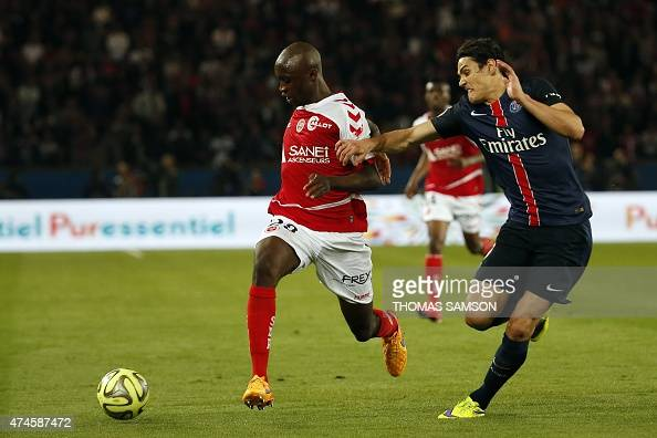 Reims' French defender Antoine Conte vies with Paris SaintGermain's Uruguayan forward Edinson Cavani during the French L1 football match between...