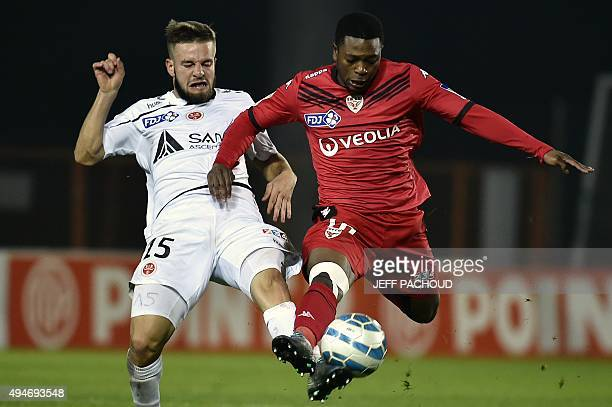 Reims' French defender Atila Turan vies with Dijon's French midfielder Jeremie Bela during the round of 32 Ligue Cup football match Dijon vs Reims on...