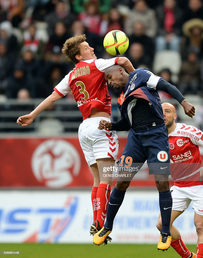 Reims' French defender Franck Signorino (L) jumps for the ball with Montpellier's Senegalese forward Souleymane Camara (R) during the French L1 football match between Reims (SDR) and Montpellier (MHSC) on April 30 2016, at the Auguste Delaune Stadium in Reims, eastern France.