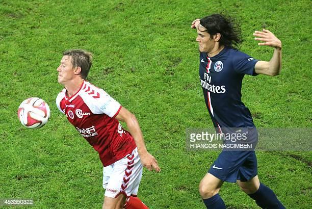 Reims' French defender Franck Signorino vies for the ball with Paris SaintGermain's Uruguyan forward Edinson Cavani during the French L1 football...