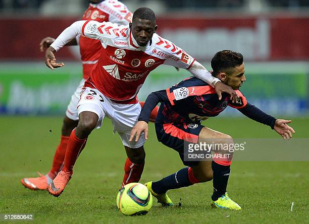Reims' French defender Mickael Tacalfred challenges Bordeaux's French midfielder Adam Ounas during the French L1 football match between Reims and...