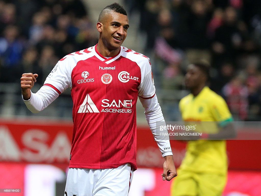 Reims' French forward David Ngog celebrates after scoring a goal during the French Football match Reims vs Nantes on March 7 2015 at the Auguste...