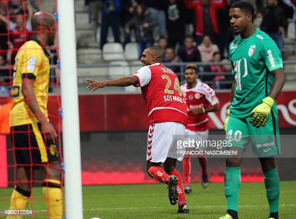 Reims' French forward David N'Gog celebrates after scoring a goal during the French Ligue 1 football match between Reims and Lille on september 25...