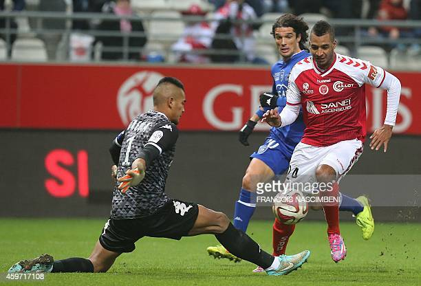 Reims' French forward David Ngog vies with Bastia's French Goalkeeper Alphonse Areola during the French L1 football match Reims vs Bastia on November...