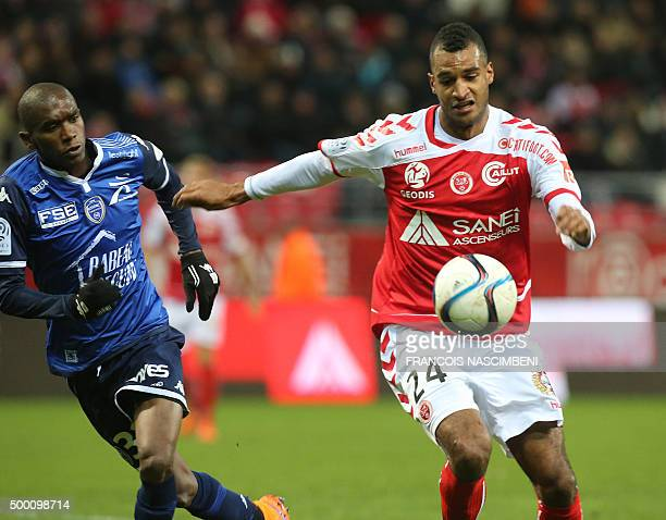 Reims' French forward David NGog vies with Troyes' defender Amele Ngcongca during the French L1 football match between Reims and Troyes on December 5...