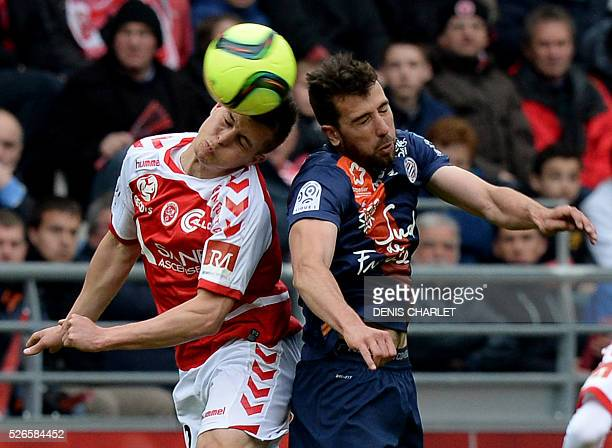 Reims' French forward Gaetan Charbonnier vies for the ball with Montpellier's French defender Mathieu Deplagne during the French L1 football match...