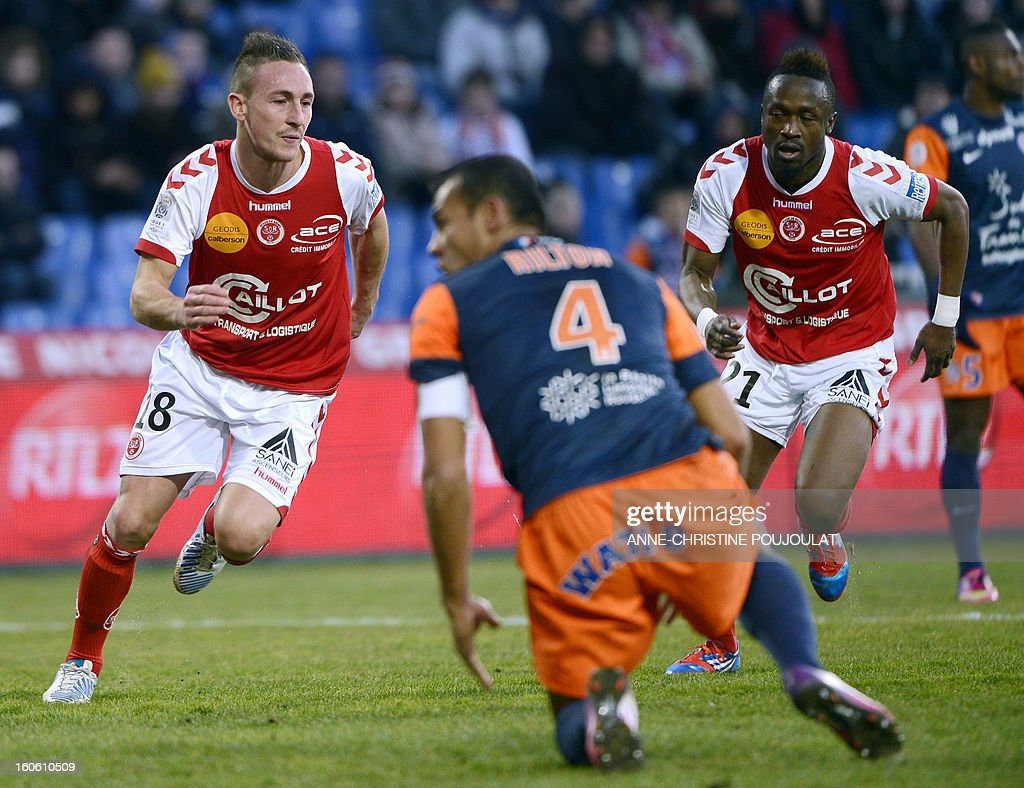 Reims' French forward Gaetan Courtet (L) reacts after scoring a goal during a French L1 football match between Montpellier and Reims on February 3, 2013 at the Mosson stadium in Montpellier, southern France.