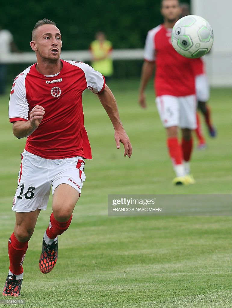 Reims' French forward Gaetan Courtet runs for the ball during a friendly football match between Stade de Reims and AS Nancy in Epernay eastern France...