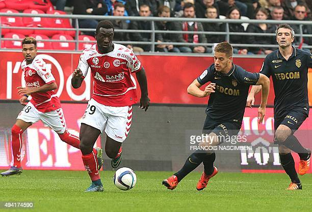 Reims' French forward Grejohn Kyei vies with Monaco's Croatian midfielder Mario Pasalic during the French Ligue 1 football match between Reims and...