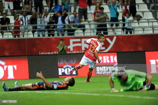 Reims' French forward Nicolas De Preville celebrates after scoring a goal during the French L1 football match between Troyes and Montpellier on...
