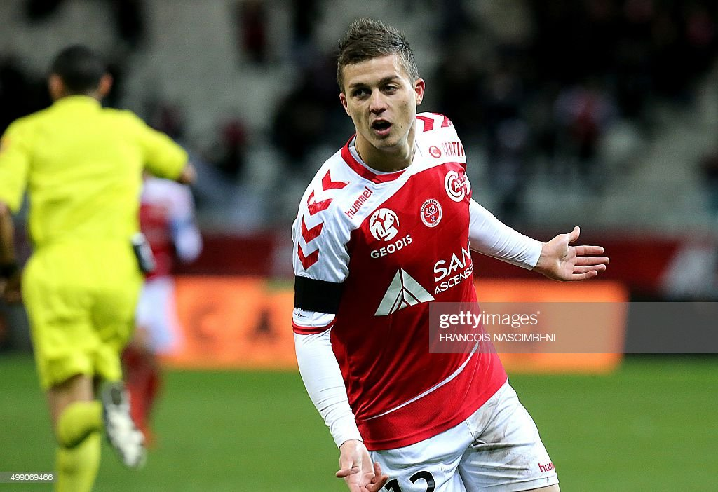 Reims' French forward Nicolas De Preville celebrates after scoring a goal during the French L1 football match between Reims and Rennes at the Auguste...