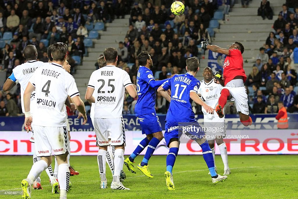 Reims' French goalkeeper Jeremy Malherbe vies with Bastia's Brazilian forward Brandao during the French L1 football match Bastia (SCB) against Reims (SR) on April18, 2015 at the Armand Cesari stadium in Bastia, on the French Mediterranean island of Corsica.
