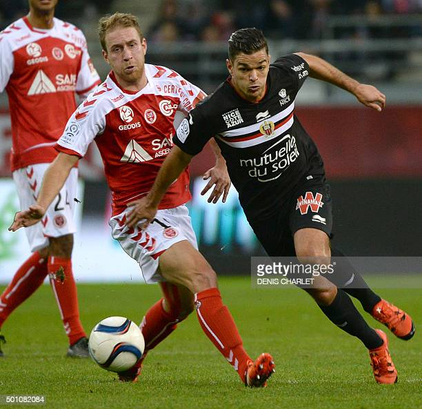 Reims' French midfielder Alexi Peuget vies with Nice's French forward Hatem Ben Arfa during the French L1 football match between Reims and Nice at...