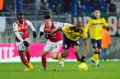 Reims' French midfielder Johan Ramare vies for the ball with Sochaux' French forward Sloan Privat during the French L1 football match between Sochaux...