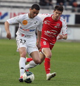 Reims' French midfielder Johan Ramare vies with Amiens' Moroccan midfielder Abdellah Kharbouchi during their French L2 football match Amiens vs Reims...