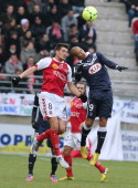 Reims' French midfielder Johan Ramare vies with Bordeaux's Cameroonian midfielder Landry Ngnemo during a French L1 football match Stade de Reims vs...