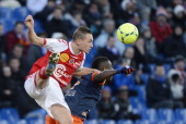 Reims' French midfielder Johan Ramare vies with Montpellier's Cameroonian defender Henri Bedimo during the French L1 championships football match...