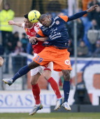 Reims' French midfielder Johan Ramare vies with Montpellier's Senegalese forward Souleymane Camara during the French L1 championships football match...