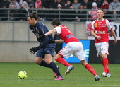 Reims' French midfielder Johan Ramare vies with Paris' forward Zlatan Ibrahimovic on March 2 2013 during the French L1 football match between Reims...