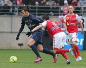 Reims' French midfielder Johan Ramare vies with Paris' forward Zlatan Ibrahimovic during the French L1 football match Reims vs Paris SaintGermain on...