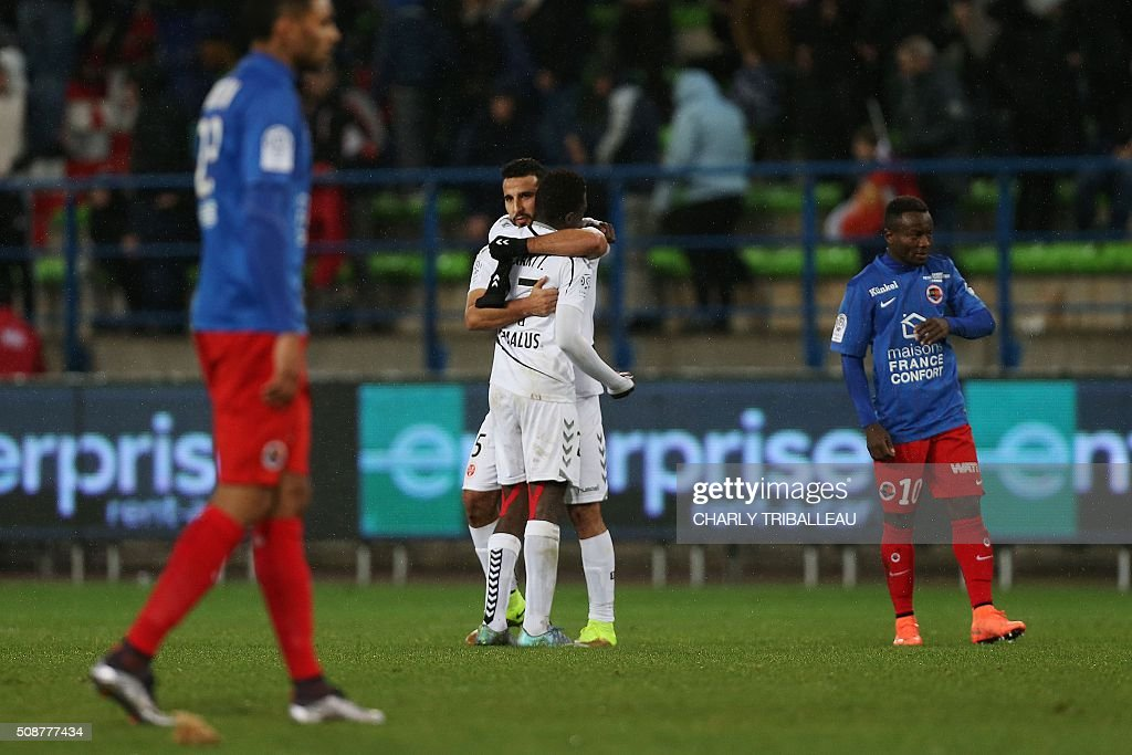 Reims' Malian defender Hamari Traore(C-L) and Abdelhamid El Kaoutari (C-R) react after the French L1 football match between Caen (SM Caen) and Reims (SD Reims), on February 6, 2016 at the Michel d'Ornano stadium, in Caen, northwestern France. AFP PHOTO / CHARLY TRIBALLEAU / AFP / CHARLY TRIBALLEAU