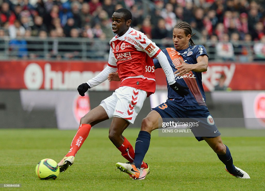 Reims' Malian defender Hamari Traore vies with Montpellier's French defender Daniel Congre (R) during the French L1 football match between Reims (SDR) and Montpellier (MHSC) on April 30, 2016, at the Auguste Delaune Stadium in Reims, eastern France.