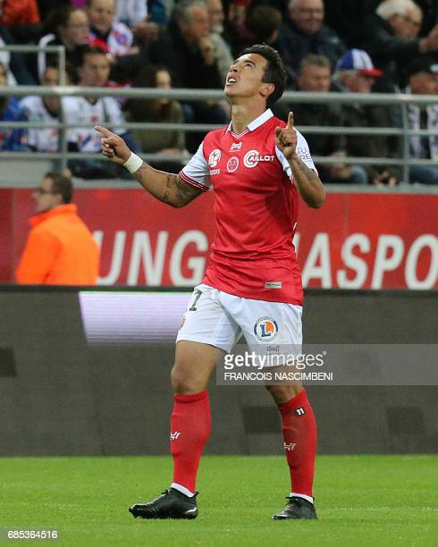 Reims' midfielder Diego Rigonato celebrates after scoring a goal during the French Ligue 2 Football match Reims versus Amiens on May 19 2017 at the...