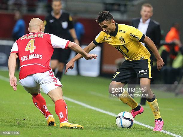 Reims' midfielder Jaba Kankava vies with Lille's French midfielder Sofiane Boufal during the French Ligue 1 football match between Reims and Lille on...