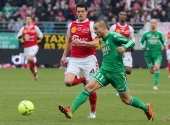 Reims midfielder Johan Ramaré fights for the ball with SaintEtienne forward Yohan Molo on February 17 2013 during a French L1 football match at the...