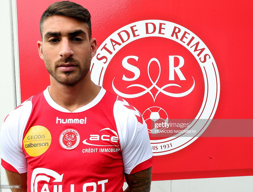 Reims' newly recruited Israeli forward Eliran Atar poses during his official presentation on Jully 1, 2013 in Reims, eastern France. Maccabi Tel Aviv's former forward Atar signed a four-year contract with French L1 football club Stade de Reims.