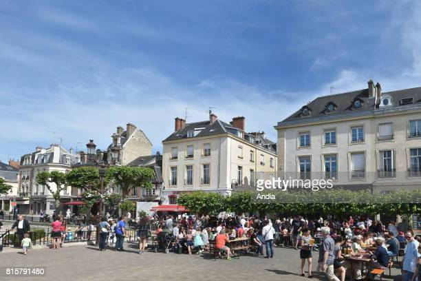 Reims 'Place du Forum' square in summer Inhabitants and tourists on terraces