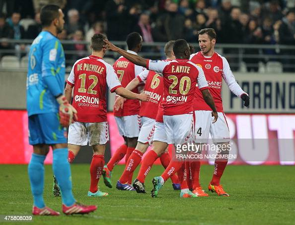 Reims' players celebrate after Nicolas de Preville scored a goal during the French football match between Reims and Valenciennes on March 1 2014 at...