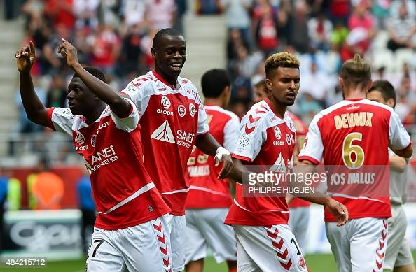 Reims' team celebrates after Reims' Malian defender Hamari Traore scored a goal during the French L1 championship football match Stade de Reims vs...