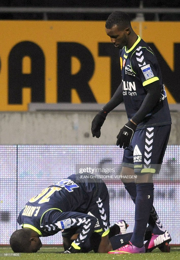Reims' Togolese forward Floyd Ayite (L) celebrates next to forward Odair Fortes of Cape Verde after scoring a goal during a French L1 football match between Nancy (ASNL) and Reims (SR) at Marcel Picot Stadium on February 9, 2013 in Tomblaine.