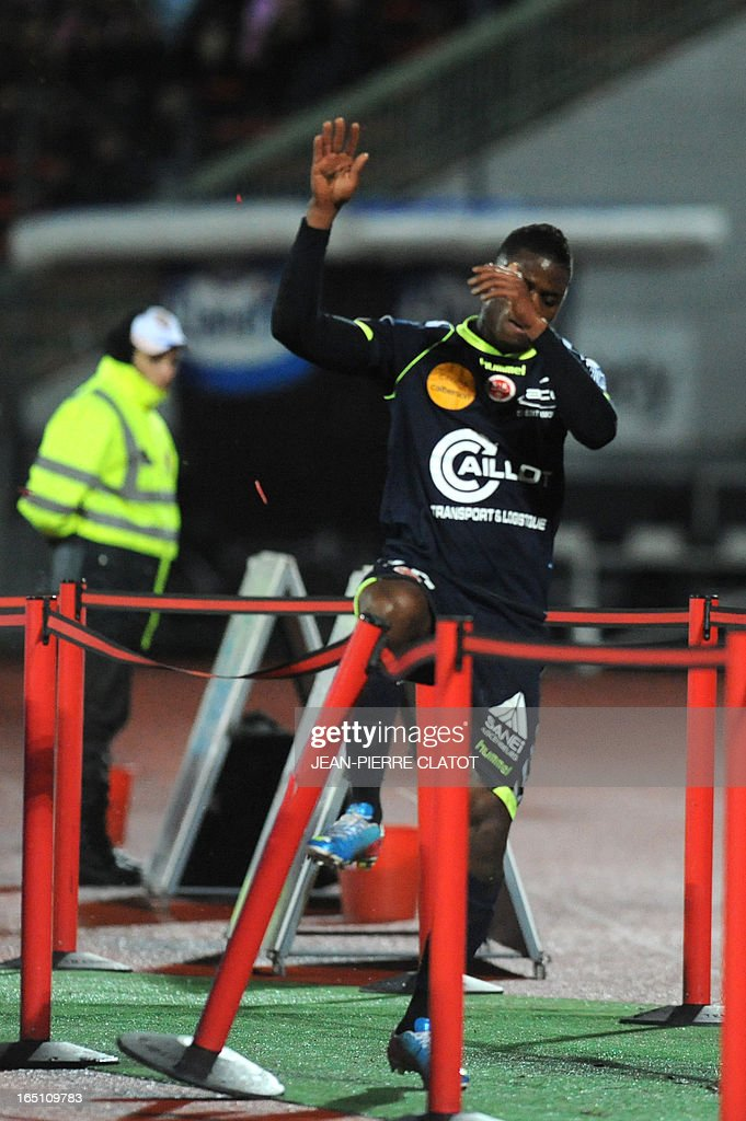 Reims' Togolese forward Floyd Ayite reacts after receiving a red card during the French L1 football match Evian (ETGFC) vs Reims (SR) on March 30, 2013 at the city stadium Parc des sports in Annecy, eastern France.